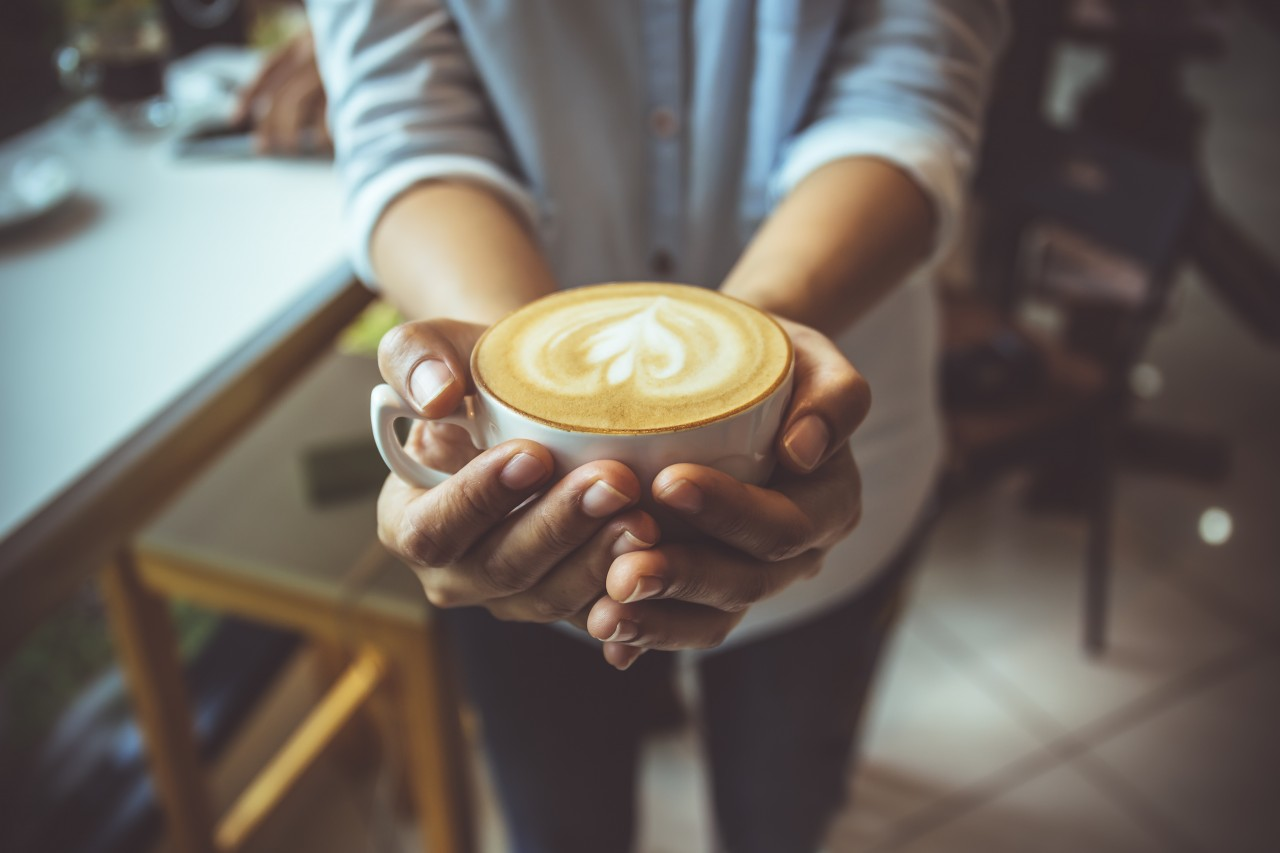 bigstock-Woman-Hand-Holding-Coffe-Cup-I-233883247